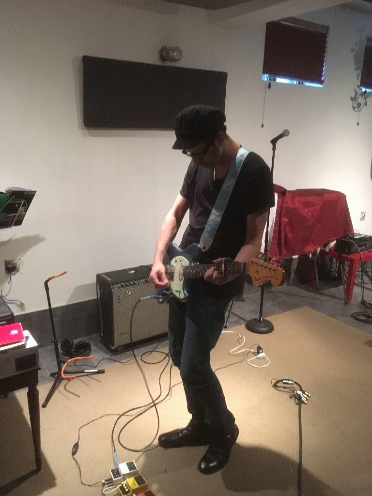 Arturo recording guitar